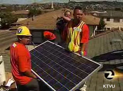 Green collar workers installing solar paneling