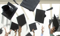 grads throwing hats in the air