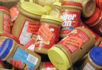 Returned jars of Peter Pan Peanut Butter are shown at a super market, in this Feb. 16, 2007, file photo in Atlanta