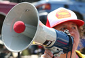 woman speaking into bullhorn